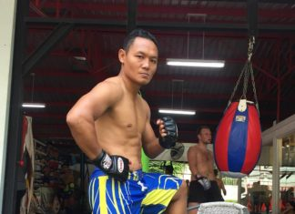 Muay Thai star Saenchai puts on MMA gloves at sparring