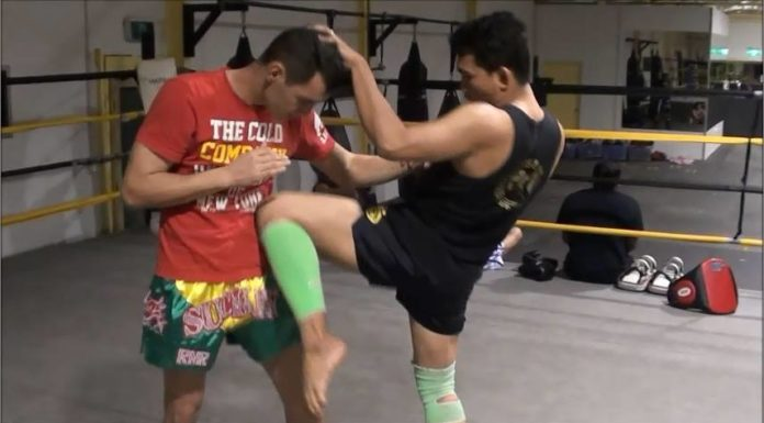 Dechsak Sangmorakot shows how to block Muay Thai clinch attempt