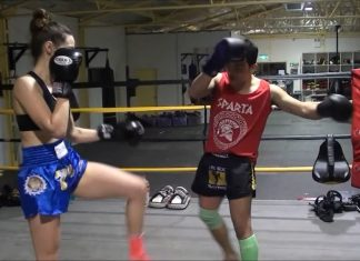 Dechsak Sangmorakot and Lilian Dikmans demonstrate push kick techniques in Muay Thai