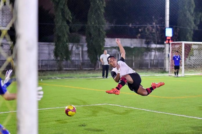 Saenchai performs flying kick in football