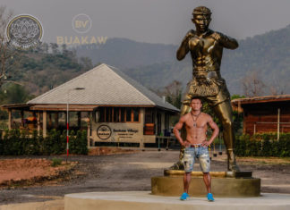 Buakaw Banchamek poses in front of his own statue