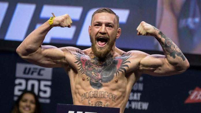 Conor McGregor former UFC champion in two weight classes weigh in