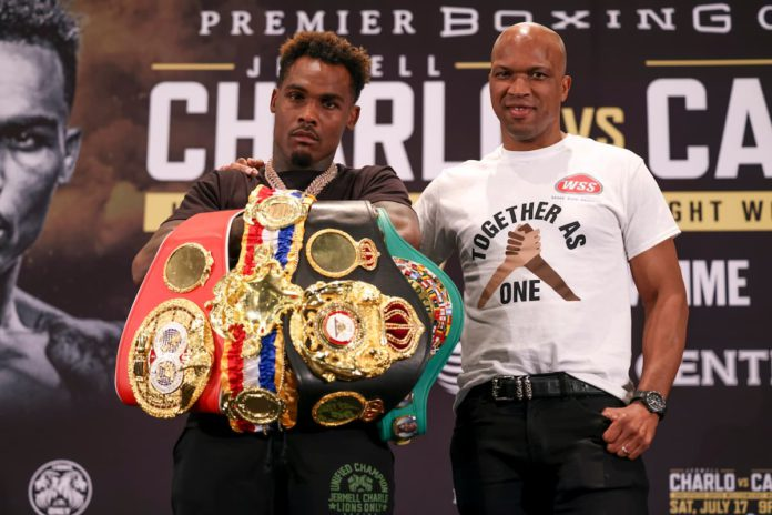 Jermell Charlo with Derrick James at press conference