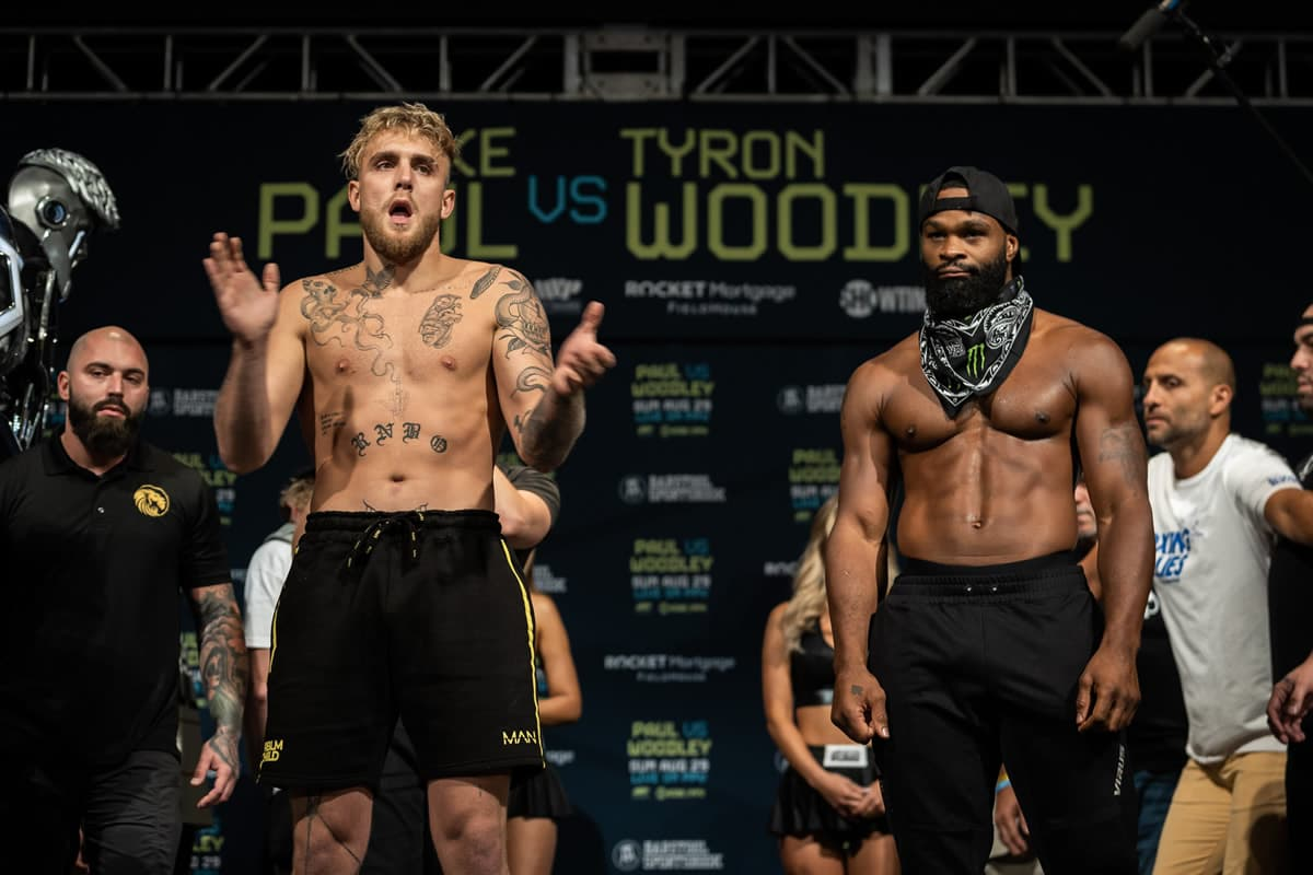 Jake Paul and Tyron Woodley at weigh-ins